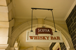 Dunedin Railway Station with sign for Scotia Whisky Bar (Dunedin was founded by Scots in 1848)