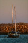 Motor schooner Beagle, crewman readying panga, Darwin Bay