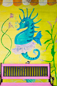 Seahorse wall art and bench outside Pine Island Dance studio