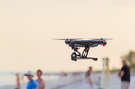 Drone, crowded beach, wedding preparations in background