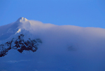 Snow blowing from glaciated peak