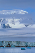 Glaciated peak and cloud above terminal wall, Antarctic Sound