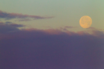 Full moon setting into cloud bank at dawn