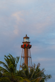 Sanibel Lighthouse with Christmas bow above palms