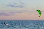 Kiteboarder in twilight, Gulf of Mexico