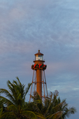 Sanibel Lighthouse with red Christmas bow, palms