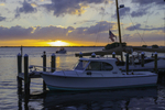 Boat leaving Tarpon Lodge docks at sunset, Pine Island Sound