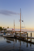 Boats moored at dock at sunset, Pine Island Sound
