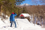 Photographer and the Pemigewasset River Covered Bridge and Mount Liberty in Winter, Historic 19th Century Wooden Bridge, The Flume, Franconia Notch State Park, White Mountains, Lincoln, New Hampshire