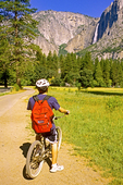 Bicyclist Viewing Yosemite Falls, Yosemite Valley, Yosemite National Park, California