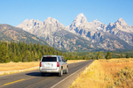 Car Driving on Road into the Teton Range, Grand Teton National Park, Jackson Hole, Wyoming