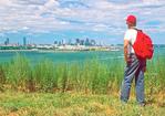 Hiker on Spectacle Island Viewing Boston, Boston Harbor Islands, Boston, Massachusetts