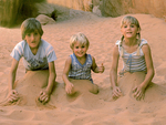 Kids in Sand near Sand Dune Arch, Arches National Park, Colorado Plateau, Moab, Utah
