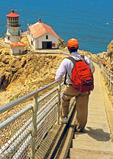 Hiker at Point Reyes Light, 19th Century Lighthouse, Pacific Ocean, Point Reyes National Seashore, California