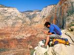 Hiker Meditating atop Angels Landing, Zion National Park, Utah