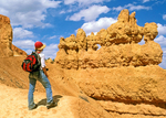 Hiker on Navaho Trail Viewing Rock Formation, Bryce Canyon National Park, Utah