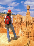 Hiker on Navaho Trail viewing Thor's Hammer Erosional Formation, Bryce Canyon National Park, Utah