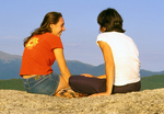 Mother and Daughter Talking on Mountain Summit