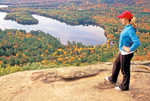 Hiker on West Rattlesnake Mountain Viewing Squam Lake, White Mountains, Holderness, New Hampshire