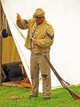 Confederate Soldier Civil War Reenactor Cleaning Musket, Civil War Reenactor