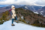 Hiker Viewing Franconia Notch from Bald Mountain in Winter, Glacially Carved U-Shaped Valley, Franconia Notch State Park, White Mountains, New Hampshire