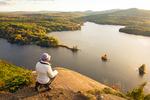 Hiker on Maiden's Cliff, Lake Megunticook, Camden Hills State Park, Camden, Maine