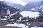 Hiker on Artist's Bluff Viewing Franconia Notch and Echo Lake in Winter, Glacially Carved U-Shaped Valley, Franconia Notch State Park, White Mountains, New Hampshire