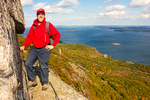 Hiker on The Precipice Trail, View of Frenchman Bay and the Atlantic Ocean, Mt. Champlain, Acadia National Park, Mount Desert Island, Maine