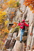 Hiker on the Precipice Trail in Autumn, Mt. Champlain, Acadia National Park, Mount Desert Island, Maine