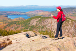 Hiker on Penobscot Mountain Summit Viewing Frenchman Bay and the Atlantic Ocean, Acadia National Park, Mount Desert Island, Maine