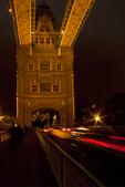Streaking Traffic Lights on Tower Bridge at Night, bascule and suspension bridge, London, England, United Kingdom,