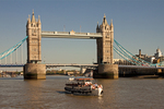 Tower Bridge and Tourboat on Thames River, bascule and suspension bridge, London, England, United Kingdom