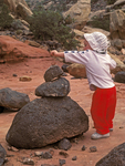 Child Playing with Lava Rocks, Cohab Canyon, Capitol Reef National Park, Utah