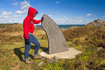 Hiker at Sunsweep Monument, sculpture symbolic of international friendship, Roosevelt Campobello International Park, Campobello Island, New Brunswick, Canada