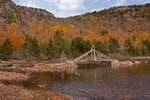Hiker on Wooden Footbridge on Jordan Pond, Acadia National Park, Mount Desert Island, Maine