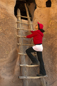 Person on Cliff Dwellings Ladder, Anasazi Puebloan Ruins, Bandelier National Monument, New Mexico