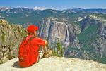 Hiker at Taft Point Viewing Yosemite Falls and Yosemite Valley, Yosemite National Park, California