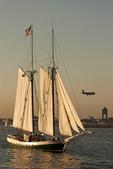 Liberty Clipper, Tall Ship Sailboat, Airplane Landing at Logan Airport, Boston Harbor, Massachusetts