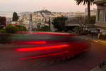 Car Streaks on Lombard Street at Night with View of the Coit Tower, San Francisco, California