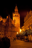 Tourists Viewing La Giralda at Night, Bell Tower for the Cathedral of Seville, 12th Century Moorish Architecture, Sevilla, Andalucia, Spain