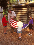 Ranger Reenactor and Children Holding American Flag, Fort Clatsop National Memorial, Lewis and Clark Expedition, Astoria, Oregon