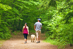 Couple and Dog Walking in Woods, Mount Major, Belknap Mountains, Alton, New Hampshire