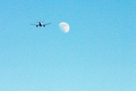 Plane Flying to the Moon