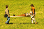 Confederate Soldiers Carrying Stretcher on Battlefield, American Civil War Reenactor