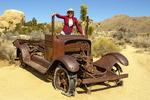 Hiker at Rusted Abandoned Truck, Wall Street Mill Trail, Joshua Tree National Park, Twentynine Palms, California