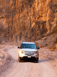 Car Driving in Titus Canyon, Grapevine Mountains, Death Valley National Park, California