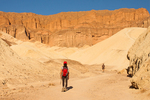 Hiker in Golden Canyon, Red Cathedral, Death Valley National Park, California