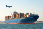 Airplane Flying Over Container Ship in Boston Harbor, Boston, Massachusetts