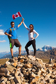 Hikers Holding Canadian Flag on Whistlers Mountain Summit, Jasper National Park, Alberta, Canada