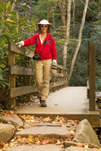 Hiker on Pedestrian Footbridge, Road Prong Creek, Chimney Tops Trail, Great Smoky Mountains National Park, Tennessee